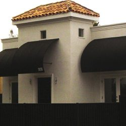 Residential awnings with black awning fabric and custom lettering