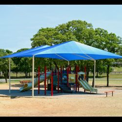 Tension shade with blue awning fabric for a playground
