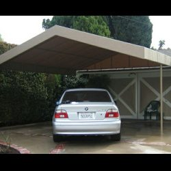 Residential carport awning with dark tan awning fabric