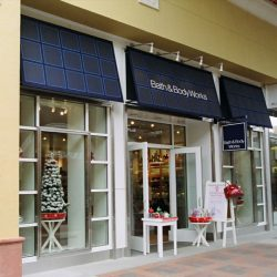 White awning graphics on a custom storefront awning for Bath & Body Works