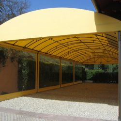 Carport awning with light yellow awning fabric