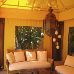 Custom cabana with yellow awning fabric and custom drapes
