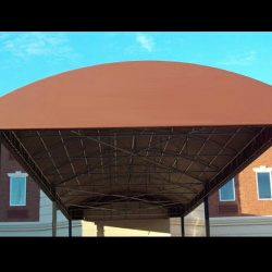 Metal walkway awning with brown awning fabric