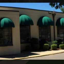Commercial window dome awnings with green awning fabric