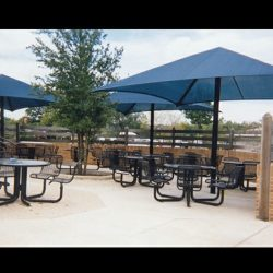 Dark blue commercial shade umbrellas for a patio