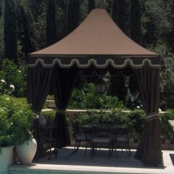 Pool cabana with brown awning fabric