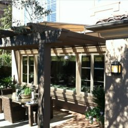 Dark residential trellis cover with light awning fabric
