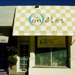 Custom awning with green and black awning graphics for Oodles