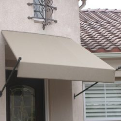 Beige awning fabric with residential spearhead awning