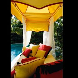 Custom pad cushions with tension shade awning and yellow awning fabric