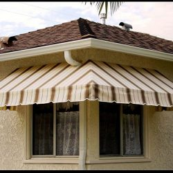 Custom residential window awning with striped awning fabric