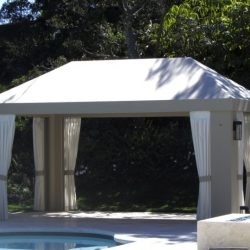 Custom cabana with grey awning fabric and white drapes