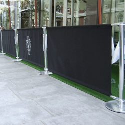 Commercial custom fabric covers with black awning fabric and white awning graphics