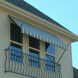 Residential window spearhead awning with striped awning fabric