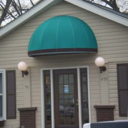Commercial dome awning with teal and black awning fabric