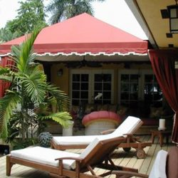 Residential cabana with red awning fabric