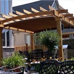 Residential wood trellis cover with dark awning fabric