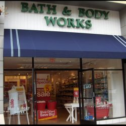 Blue storefront awning with awning graphics for Bath & Body Works