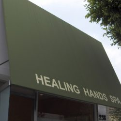 Green commercial awning for Healing Hands Spa