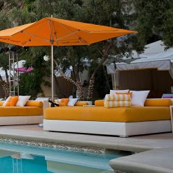 Custom orange patio cushions and orange commercial shade umbrellas