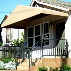 Residential entrance awning with yellow awning fabric