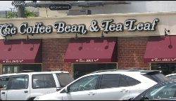 Dark red window awning for The Coffee Bean & Tea Leaf
