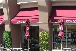 Dark red window canopy and awning graphics in Van Nuys