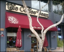 Custom dark red storefront awning for The Coffee Bean
