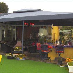 Dark grey patio shade awning with custom awning fabric