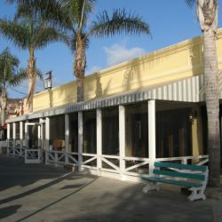 Striped storefront awning with white beams