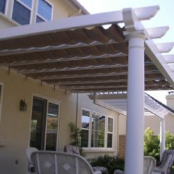 Residential trellis cover with retractable awning fabric