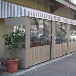Beige storefront awning with white striped awning fabric