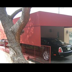 Custom carport awning with red awning fabric and drop-roll cover