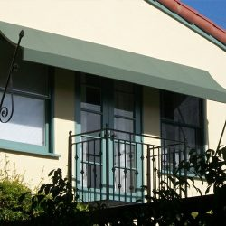 Green residential spearhead awning for a balcony