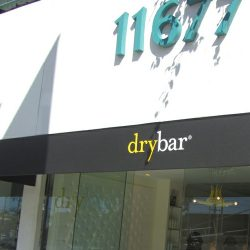 Custom storefront awning with black awning fabric for Drybar