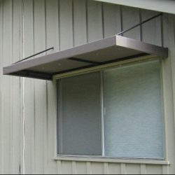 Custom metal window awning for a home