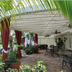 Custom patio shade awning with red drapes