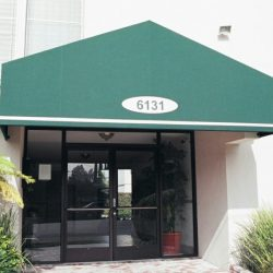 Green entrance awning with custom awning graphics