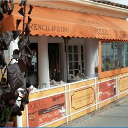 Custom orange storefront awning for Soleil French Bistro