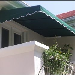 Green patio shade awning with white awning fabric accents