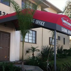 Red and black entrance awning for Santo Tomas' leasing office