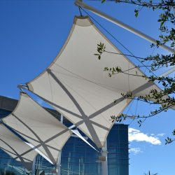Commercial tension shades with white awning fabric
