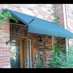Green awning fabric on a residential spearhead awning