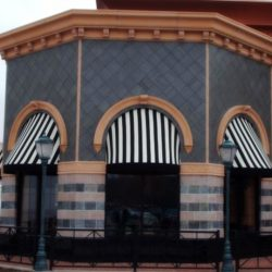 Striped dome awning with black and white awning fabric