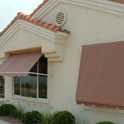 Rust colored residential retractable window awnings