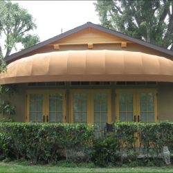 Residential dome awning with light orange awning fabric