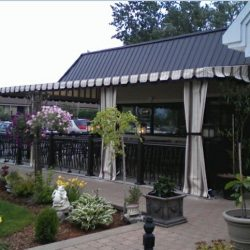 Commercial patio shade awning with custom white and olive awning fabric