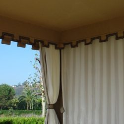 Cabana with custom striped drapes