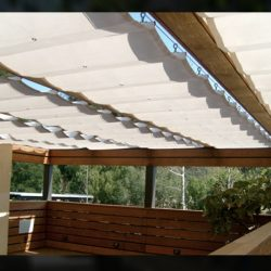Residential slide on wire awning with white awning fabric