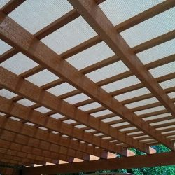 Wood trellis cover with beige awning fabric